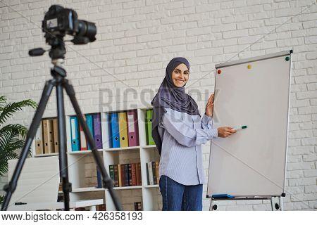 Arabian Female Coach Making A Video As She Showing Something On A Whiteboard