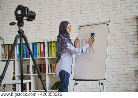 Muslim Teacher Cleaning The Whiteboard While Making A Video