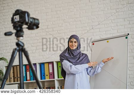 Beautiful Muslim Woman Making A Video, Explaining Something With A Whiteboard
