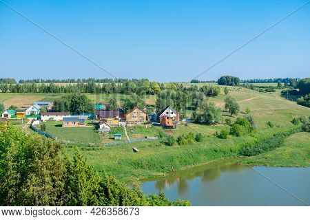 Village Near Lake. Landscape Of The Village With Beautiful Views Of The Forest And Lake