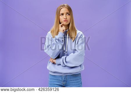 Silly Concerned Girlfriend Trying Think Up How Solve Problem Standing Thoughtful With Troubled Expre