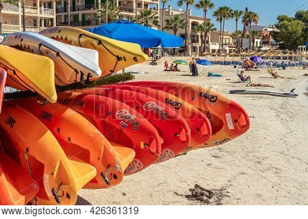 Colonia De Sant Jordi, Spain; July 02 2021: Close-up Of Some Canoes Piled Up On The Beach Of The Col