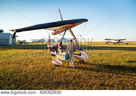 Odessa, Ukraine - July 14, 2016: Young Woman Standing Near A Motor Hang Glider At Aerodrome.