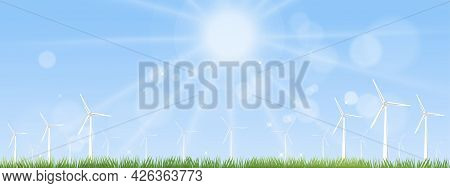Windmill For Electric Power Productions On Green Grass Fields,spring Morning Sky,cloud With Alternat