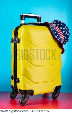 Luggage Suitcase And Panama. Suitcase And American Flag. Bag And Headpiece With The American Flag.