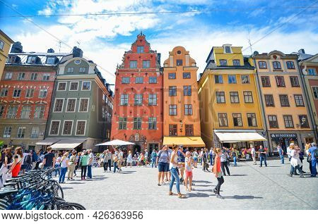 Stockholm, Sweden - July 15, 2017 : Beautiful Traditional Colorful Buildings, Fountain And Tourists