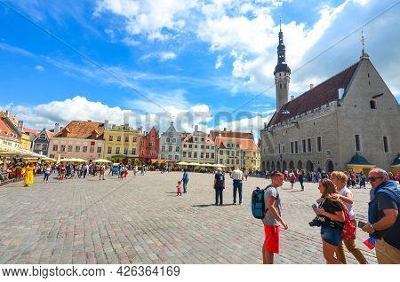 Tallinn, Estonia - July 10, 2017 : Tourists Enjoying A Sunny Day At Beautiful Medieval Town Hall Squ