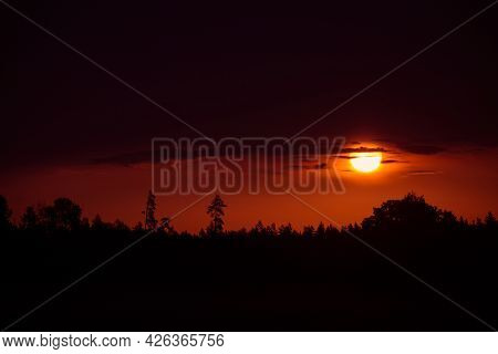 The Summer Sun Rising Over A Rural Scenery. Sunrise Landscape. Summertime Scenery Of Northern Europe