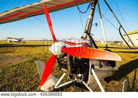 Close Up Of Propellerof Motor Hang Glider Standing On Green Grass At Aerodrome, Bright Summer Day