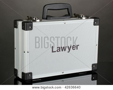 Silvery diplomat (suitcase) on grey background