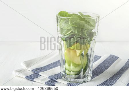 Glass With Ingredients For Green Smoothie: Spinach, Apple, Cucumber. Home Cooking. Vegan Healthy Det