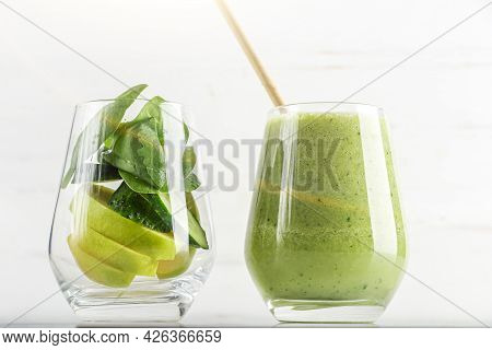 Glass With Green Smoothie And Glass With Ingredients Spinach, Apple, Cucumber. Home Cooking. Vegan H