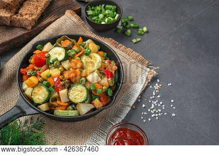Healthy, Baked Vegetables And Fresh Herbs On A Gray-brown Background. Side View, Close-up.