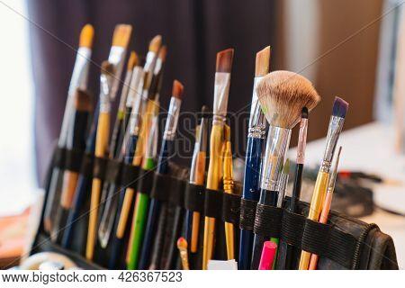Professional Makeup Brushes And Aqua Makeup. Services Of Make-up Artist