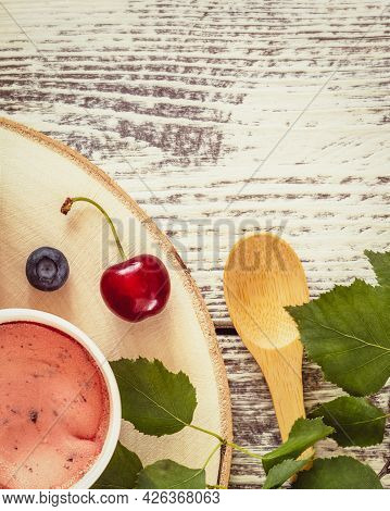 Summer, Food Composition With Natural, Vegan Ice Cream, Blueberries, Cherry, Leaves And Wooden Spoon