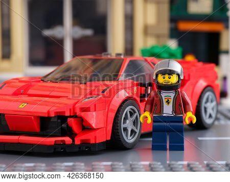 Tambov, Russian Federation - July 02, 2021 Lego Driver Minifigure Near His Car Ferrari F8 Tributo By