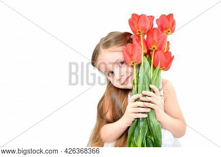 Portrait Of A Cute Smiling Girl Holding A Bouquet Of Tulips In Her Hands Isolated On White Backgroun