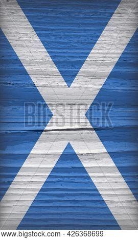 Flag Of Scotland On A Dry Wooden Surface. Vertical Vintage Backdrop Made Of Old Wood. Natural Backgr