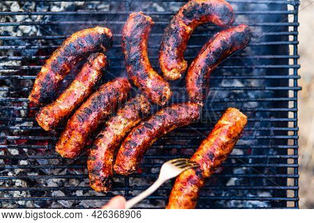 Grilling Sausages On Barbecue Grill. Delicious Sausages On Charcoal Grill