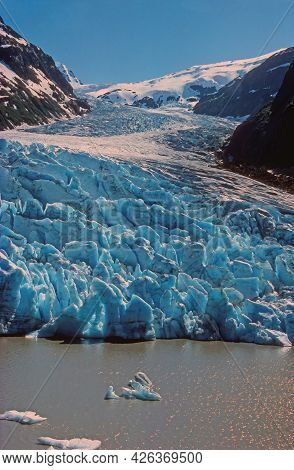 Dramatic Bear Glacier Coming Out Of The Sky Near Stewart, Bc In Canada