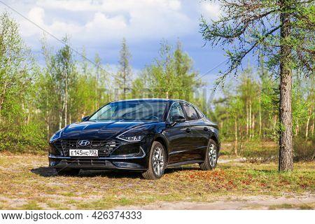 Novyy Urengoy, Russia - June 14, 2021: New Saloon Car Hyundai Sonata In The Pine Forest.