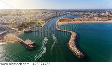 Aerial View From The Sky Of The Portuguese Coastline Of The Algarve Zone Of Lagos City. Boats And Sh