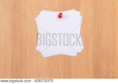 White Sticky Notes With Copyspace Pinned To The Wooden Message Board. To Do List Reminder In Office.