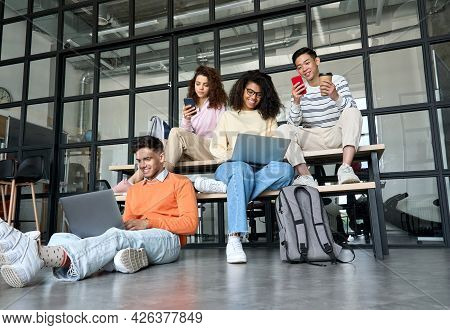 Young Happy Cheerful Multiethnic Cool Group Of High School College Students Girls And Guys Sitting A