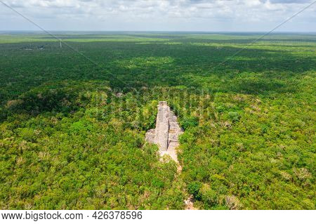 Aerial View Of The Maya Pyramid Lost In The Middle Of A Jungle.