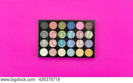 Eyeshadow Multicolor Palette Isolated On Pink Paper Background.