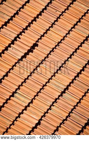 Red Terracotta Tiles Of A Building, Repetitive Roof Texture Background Architectural