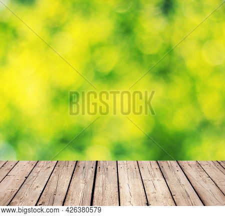 Wooden Timber Floor And Green Bokeh Background