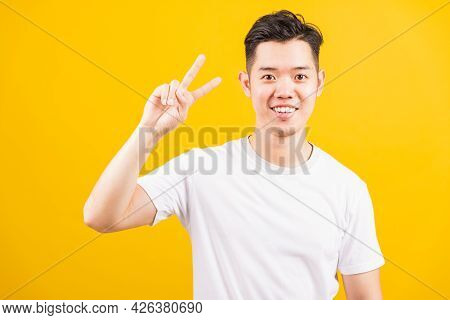 Portrait Happy Asian Handsome Young Man Smiling Standing Wearing White T-shirt He Showing Fingers Do