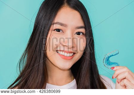 Portrait Young Asian Beautiful Woman Smiling Holding Silicone Orthodontic Retainers For Teeth, Teeth
