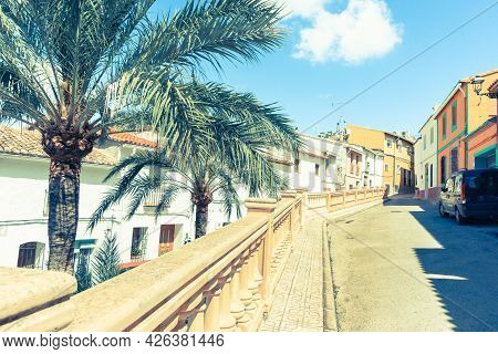 Retro Or Vintage Style Image Colors Street Image Homes And Street Lined By Palm Trees And Balustrade