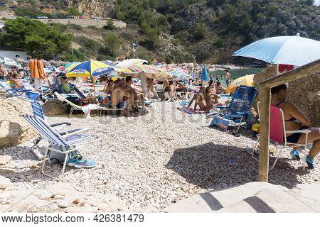 La Granadella  Spain - August 20 2016; Busy And Over-crowded Beach In Summer At La Granadella, Alica