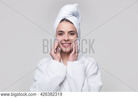 Beautiful Young Woman Touching Her Face With Sponge And Smiling.