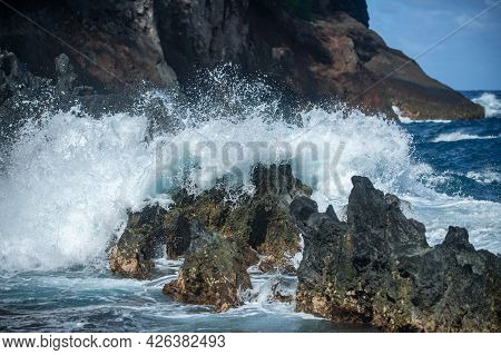 Sea Stone Beach, Sea Waves. Colorful Blue Sea Background. The Concept Of Summer Vacation And Travel.