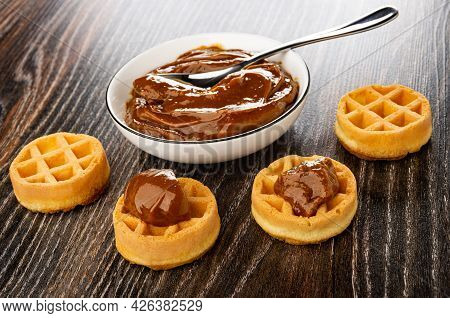 Teaspoon In White Bowl With Condensed Milk, Sandwiches From Soft Biscuit Waffles With Boiled Condens