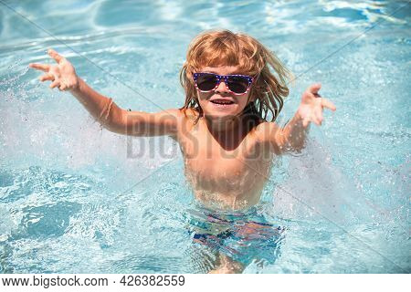 Cute Child Boy Swim In Swimming Pool, Summer Water Background With Copy Space. Cute Boy In The Water