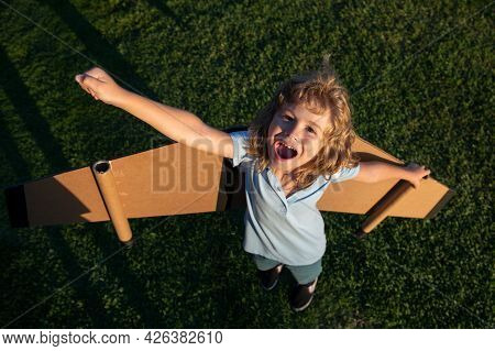 Excited Kid Boy Leader And Winner, Success Start Up. Excited Child Boy Play With Toy Jetpack Wings S