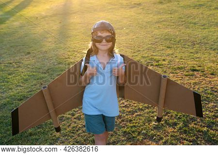 Child Boy Playing With Toy Airplane Wings. Dream Of Becoming A Pilot. Superhero Flying. Boy Dreams O