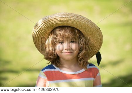 Head Close Up. Close Up Head Shot Of Child In Straw Hat. Kids Face, Little Boy Portrait.