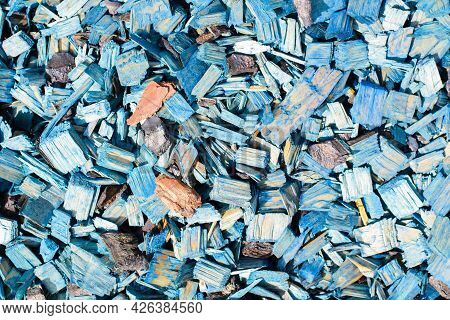 Blue Decorative Chips, Wood Textured Background Top View. Shredded Tree Bark For Decorating A Garden