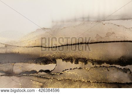 Art Abstract  watercolor marble flow blot painting. Black and gold Color canvas texture horizontal background. Alcohol ink.