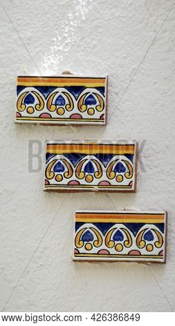 Decorative Tile Cuttings On Whitewashed Wall In Andalusian Village House