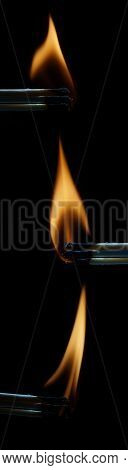 Large Striking Matches Lighter With Its Flame Glowing On A Black Background