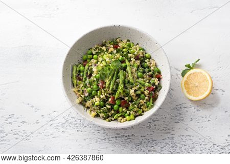 Traditional Middle Eastern Or Arabic Tabbouleh Salad Of Bulgur, Tomatoes, Asparagus, Green Peas And