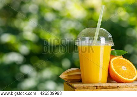 Disposable Plastic Glass Of Cold Freshly Squeezed Orange Juice