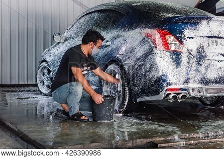 Cleaning The Car (car Detailing) At Car Care Shop